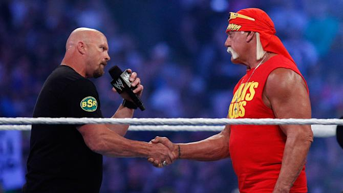 """""""Stone Cold"""" Steve Austin, left, and Hulk Hogan shake hands during Wrestlemania XXX at the Mercedes-Benz Super Dome in New Orleans on Sunday, April 6, 2014. (Jonathan Bachman/AP Images for WWE)"""