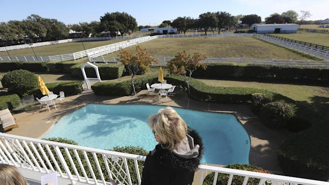 """Shown in this photo made Tuesday, Nov. 13, 2012, is the backyard pool of the mansion at Southfork Ranch made famous by the Dallas TV  show in Parker, Texas. Tourists have been flocking to Southfork Ranch since the early years of the classic series, which ran from 1978 to 1991. And a new """"Dallas"""" starting its second season on TNT on Monday and the recent death of the show's star, Larry Hagman, who legendarily played conniving Texas oilman J.R. Ewing, have also spurred fans to visit. (AP Photo/LM Otero)"""
