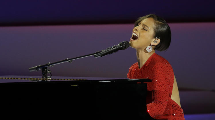 CORRECTS SPELLING TO ALICIA NOT ALICA- Alicia Keys performs during Inaugural Ball in the Washington Convention Center at the 57th Presidential Inauguration in Washington, Monday, Jan. 21, 2013. (AP Photo/Paul Sancya)