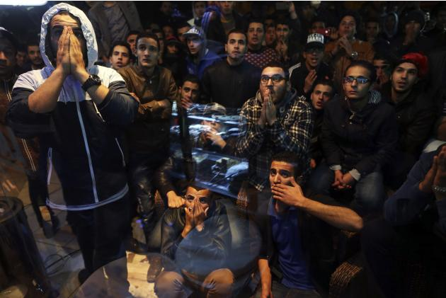 Libyans watch the African Nations Championship final soccer match between Libya and Ghana at a cafe in Benghazi