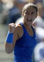 Sara Errani, of Italy, reacts after a point against Venus Williams, of the United States, during the third round of the 2014 U.S. Open tennis tourname...