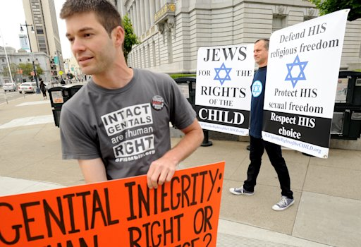 Anti-circumcision activists Jonathon Conte, left, and Brian Levitt rally with about 25 protesters outside a San Francisco courthouse