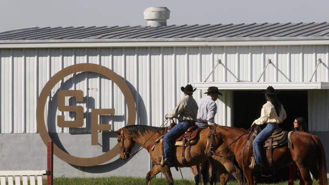 "In this photo made Tuesday, Nov. 13, 2012, stunt riders prepare to shoot a scene for the TV show Dallas at Southfork Ranch in Parker, Texas. Tourists have been flocking to Southfork Ranch since the early years of the classic series, which ran from 1978 to 1991. And a new ""Dallas"" starting its second season on TNT on Monday and the recent death of the show's star, Larry Hagman, who legendarily played conniving Texas oilman J.R. Ewing, have also spurred fans to visit. (AP Photo/LM Otero)"