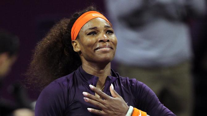 Serena Williams of the U.S. celebrates after winning against Czech Republic's Petra Kvitova in their WTA Qatar Ladies Open tennis quarterfinal match in Doha, Qatar, Friday, Feb. 15, 2013. (AP Photo/Osama Faisal)