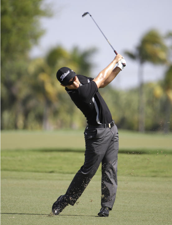 Jin Jeong of South Korea hits from the eighth fairway during a continuation of the first round of the Cadillac Championship golf tournament, Friday, March 7, 2014, in Doral, Fla. Play was suspended be
