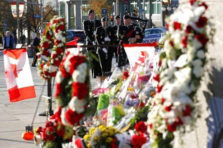 The day's first posting of the sentries arrive at the National War Memorial in Ottawa