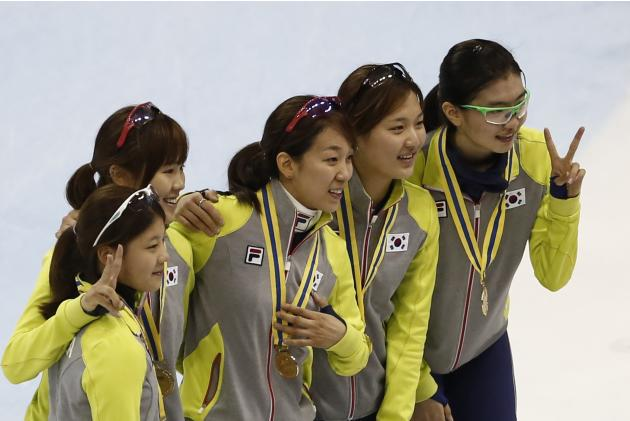 South Korea's skating team pose during the medal ceremony after winning the women's 3000m relay final during the ISU Short Track World Cup speed skating competition in Shanghai