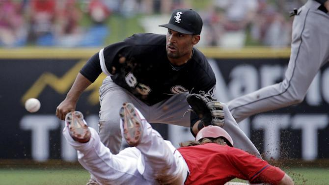 Los Angeles Angels' Collin Cowgill is caught stealing as Chicago White Sox's Micah Johnson makes the play during the third inning of an exhibition spring training baseball game Thursday, March 13, 2014, in Tempe, Ariz