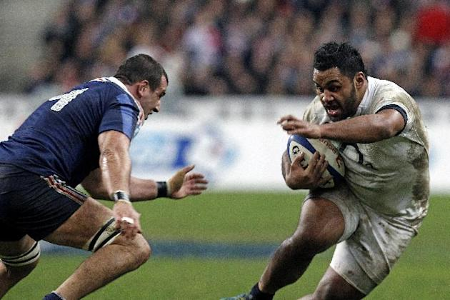 England's Billy Vunipola runs with the ball as France's Yoann Maestri tries to stop him, during their Six Nations rugby union international match, at the Stade de France, in Saint Denis, outsi