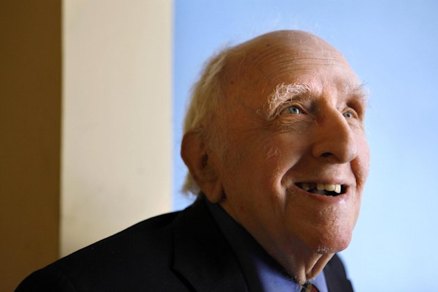 FILE - In this June 1, 2009 file photo, Frank Kameny is seen in his home in Washington. A Canadian amateur astronomer who discovered several asteroids has named one after U.S. gay rights pioneer Frank Kameny who died last year in Washington. Kameny, who earned a doctorate in astronomy at Harvard University, was an astronomer with the U.S. Army Map Service in the 1950s but was fired from his job for being gay. He contested the firing all the way to the Supreme Court and later organized the first gay rights protests outside the White House, the Pentagon and in Philadelphia in the 1960s. Kameny died last year at age 86. (AP Photo/Jacquelyn Martin, File)