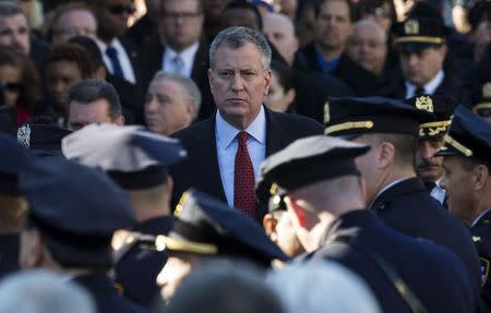 New York City Mayor Bill de Blasio exits the Christ Tabernacle Church following the funeral service for slain New York Police Department (NYPD) officer Rafael Ramos in the Queens borough of New York