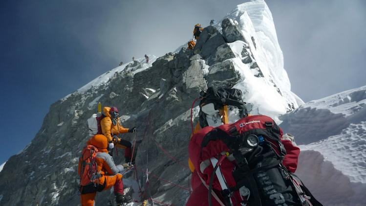 Nepal to slash fees to climb overcrowded Everest