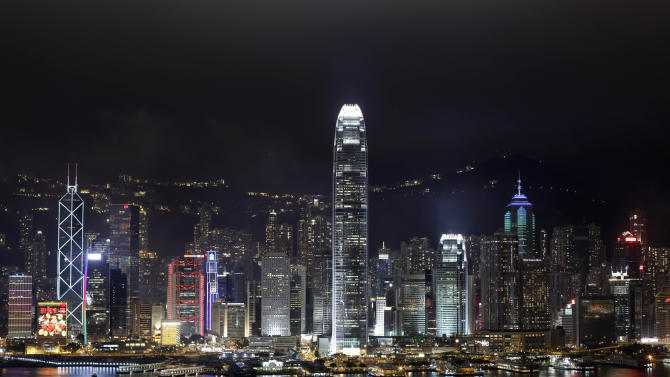 In this Tuesday, Jan. 24, 2012 photo, a night view of the Hong Kong Island's legendary skyline is seen. With its bustling harbor and glittering, neon-drenched skyscrapers set against a backdrop of verdant, towering peaks, Hong Kong is undeniably one of the world's most scenic cities. (AP Photo/Vincent Yu)