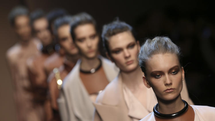 Models wear creations for Gianfranco Ferre' women's Fall-Winter 2013-14 collection, part of the Milan Fashion Week, unveiled in Milan, Italy, Monday, Feb. 25, 2013. (AP Photo/Luca Bruno)