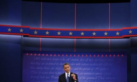 Obama speaks during the presidential debate on Oct. 3: In the next two debates, the president would likely benefit from calling Mitt Romney out on his flip-flopping and demanding specifics to the GOP challenger's proposed plans.