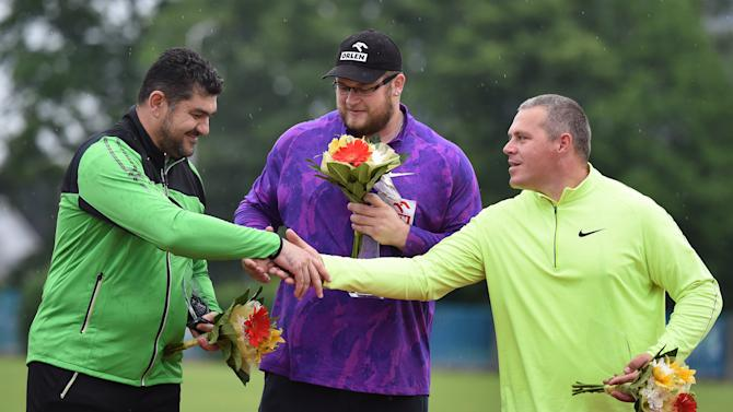 Second placed Dilshod Nazarov from Tadzhikistan, left, shakes hands with third placed Krisztian Pars from Hungary, right, as the winner Pawel Fajdek from Poland, centre, looks on after the hammer throwing event at the Golden Spike international athletic meeting in Ostrava, Czech Republic, Monday, May 25, 2015.  (Jaroslav Ozana/CTK via AP) SLOVAKIA OUT