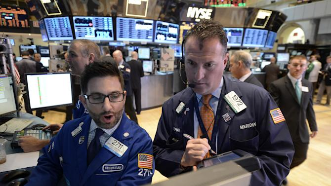 Christian Sanfilippo Jr., left, and William Bott, both of Barclays, work on the floor of the New York Stock Exchange, Wednesday, Feb. 13, 2013 in New York. (AP Photo/Henny Ray Abrams)