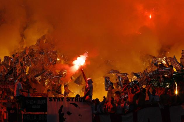 Legia Warsaw supporters light flares as they cheer for their team before their Europa League soccer match against Lazio at the Olympic stadium in Rome