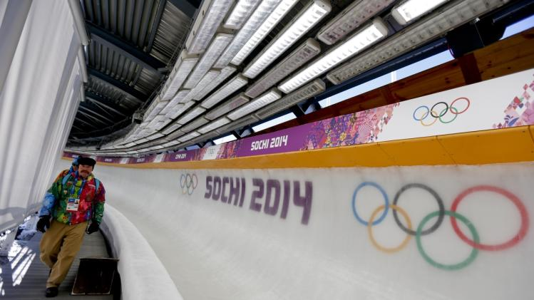 Former luger Carl Roepke, who will be announcing bobsleigh, skeleton and luge in English, walks at the Sanki Sliding Center ahead of the 2014 Winter Olympics, Monday, Feb. 3, 2014, in Krasnaya Polyana, Russia