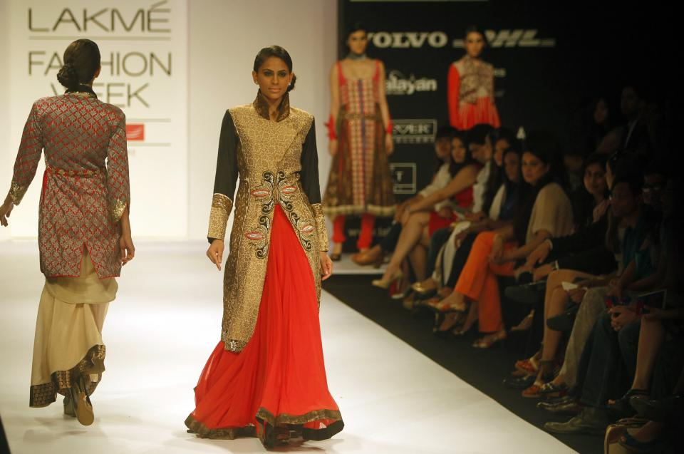 An Indian model displays a creation by Nandita Thirani during the Lakme Fashion Week in Mumbai, India, Friday, Aug. 3, 2012. (AP Photo/Rafiq Maqbool)