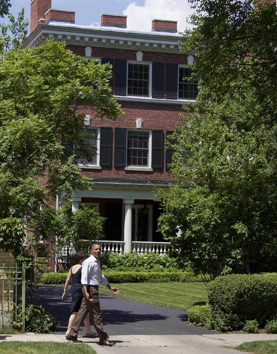 President Barack Obama walks through his Hyde Park neighborhood with senior advisor Valerie Jarrett to his friend Marty Nesbitt's home, Saturday, June 2, 2012, in Chicago. (AP Photo/Carolyn Kaster)