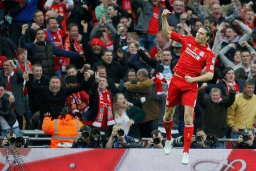Liverpool's striker Andy Carroll celebrates scoring