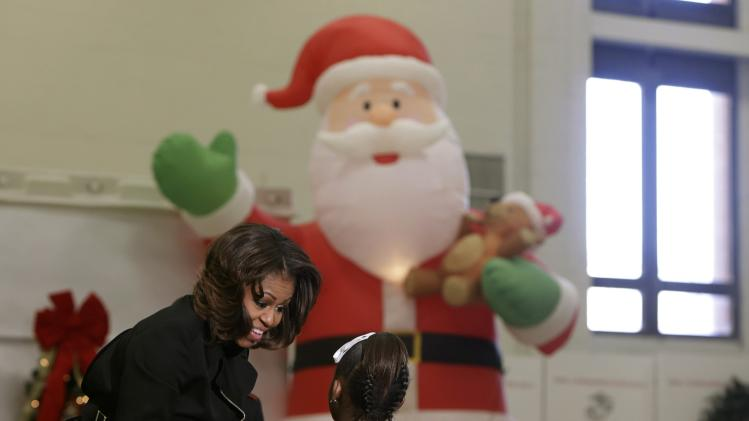US First Lady Michelle Obama greets children while participating in Toys for Tots holiday campaign in Washington