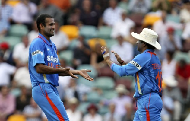 India's Pathan celebrates with teammate Tendulkar after he took the wicket of Australia's Warner during their one-day international cricket match in Brisbane