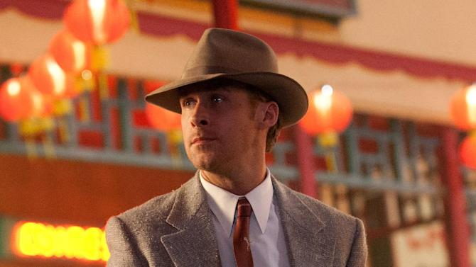 """FILE - This publicity film image released by Warner Bros. Pictures shows Ryan Gosling, as Sgt. Jerry Wooters in the film, """"Gangster Squad."""" """"This isn't a movie promoting violence,"""" said """"Gangster Squad"""" producer Dennis Lin. """"It's a movie about unsung heroes."""" (AP Photo/Warner Bros. Pictures, Jamie Trueblood, File)"""