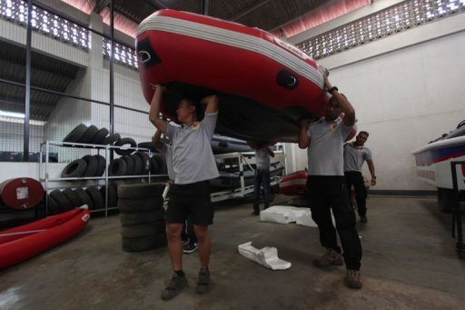 &lt;p&gt;In anticipation of Typhoon Bopha, rescuers prepare equipment in Davao City, on the southern island of Mindanao. More than 53,000 people have moved into nearly 1,000 government shelters, the civil defence office says&lt;/p&gt;