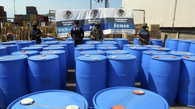FILE - In this Dec. 28, 2011, file photo released by the Mexican navy, Navy marines stand guard over barrels containing 120,000 kilograms of methylamine, a precursor chemical, seized at the Pacific port of Lazaro Cardenas, Mexico, that were headed for Guatemala. The meth problem is spilling into other parts of Latin America, too, almost all of it bound for Guatemala. (AP Photo/SEMAR, File)