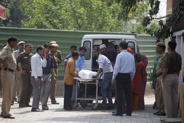 Unidentified relatives of Ram Singh, one of the men on trial for his alleged involvement in the gang rape and fatal beating of a woman aboard a New Delhi bus, carry Singh's body in to a waiting hearse