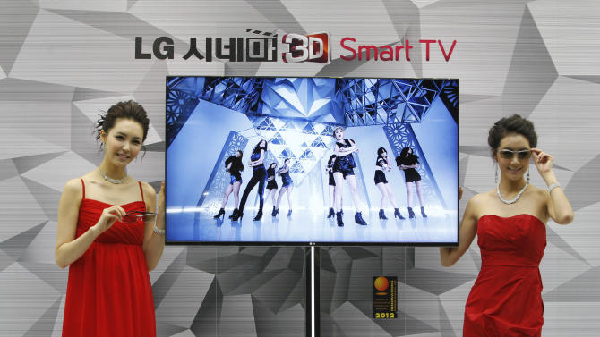 FILE - In this Thursday, Jan. 19, 2012 file photo, South Korean models pose with a CINEMA 3D Smart TV during a press conference to introduce the LG Electronics' television and the company's marketing strategy for 2012 in Seoul, South Korea. LG Electronics Inc. said it is investigating a claim that some of its smart TVs send information on home viewing habits back to the company without consent. The investigation comes after Jason Huntley, a 45-year-old IT consultant in Britain, detailed in his blog how his LG smart TV logged the channels he was watching and sent the data to LG. (AP Photo/Ahn Young-joon, File)