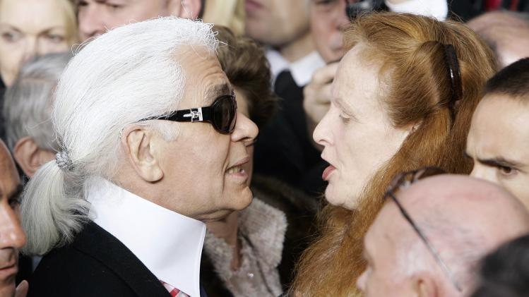 "FILE- this Jan. 23, 2007 file photo shows Vogue magazine's Grace Coddington, right, talking with German fashion designer Karl Lagerfeld after the presentation of Chanel's spring-summer 2007 Haute Couture fashion collection, designed by Lagerfeld, at the Grand Palais in Paris. Coddington is the author of a book titled, ""Grace: A Memoir,"" released Nov. 20, 2012 by Random House. (AP Photo/Francois Mori, File)"