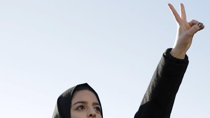 Isra Ayesh, the Organizing Director of Americans for Refugees and Immigrants, speaks at a pro-refugee protest organized by her group in Seattle, Washington