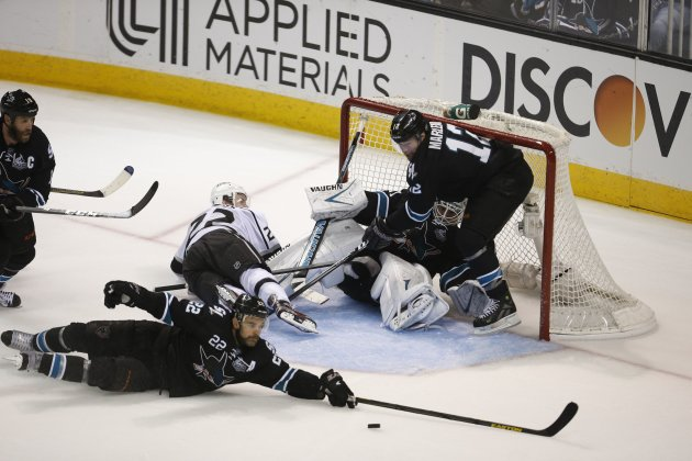 Sharks' Boyle slides for the puck as Kings' Lewis commits a goaltending interference in the third perioduring Game 3 of NHL Western Conference semifinal series in San Jose