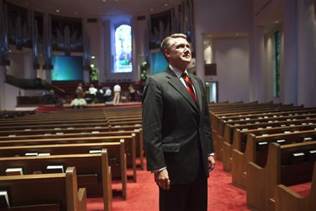 "Pastor Mark Harris of First Baptist Church stands for a portrait in the sanctuary prior to giving his sermon during the fifth and largest ""Pulpit Freedom Sunday"" in Charlotte, North Carolina October 7, 2012. More than 1,300 pastors across the country climbed to the lectern just weeks before the U.S. presidential and congressional elections, to urge people to vote for or against particular candidates. Such pulpit pleading could endanger a church's tax-exempt status by violating IRS rules. A charity can take a position on policy issues but cannot act ""on behalf of (or in opposition to) any candidate for public office."" REUTERS/John Adkisson"