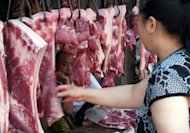 A Chinese customer selects pieces of pork at a market in Yichang, central China's Hubei province in July 2011. China has arrested around 2,000 people and closed nearly 5,000 businesses in a major crackdown on illegal food additives, the government said, after a wave of contamination scares