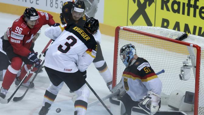 Switzerland's Brunner tries to score against Germany's goaltender Pielmeier during their Ice Hockey World Championship game at the O2 arena in Prague