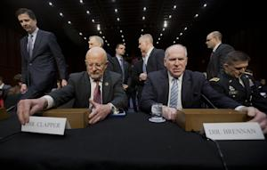 Director of National Intelligence James Clapper, foreground …