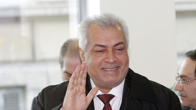 Iraq's Minister of oil and President of the Conference Abdul-Kareem Luaibi Bahedh arrives for the start of the meeting of the Organization of the Petroleum Exporting Countries, OPEC, at their headquarters in Vienna, Austria, Wednesday, Dec. 12, 2012 . (AP Photo/Ronald Zak)