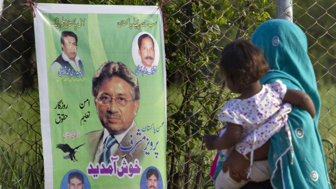 A Pakistani woman looks at a poster of former military ruler Gen. Pervez Musharraf along a roadside on the outskirts of Islamabad, Pakistan on Sunday, April 7, 2013. Musharraf was given approval on Sunday to run for parliament in a remote northern district after being rejected in two other parts of the country, his aide said. (AP Photo/Anjum Naveed)