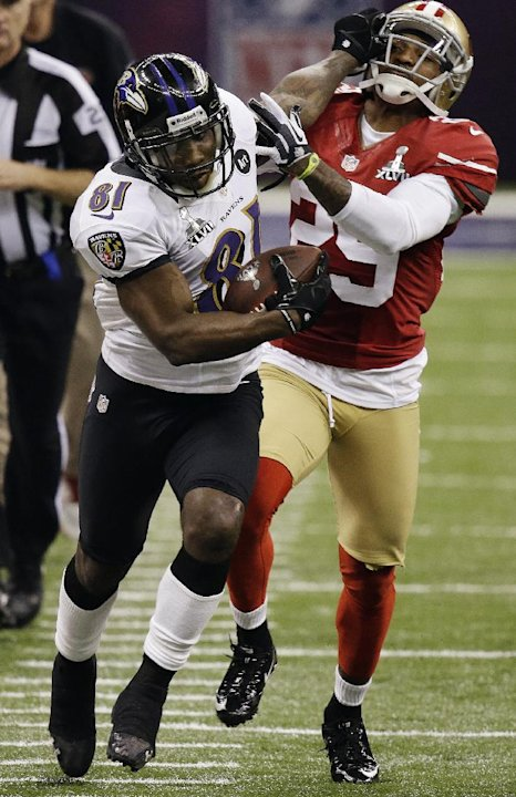 FILE - In this Feb. 3, 2013, file photo, Baltimore Ravens wide receiver Anquan Boldin (81) stiff-arms San Francisco 49ers cornerback Chris Culliver (29) during the second half of the NFL Super Bowl XL