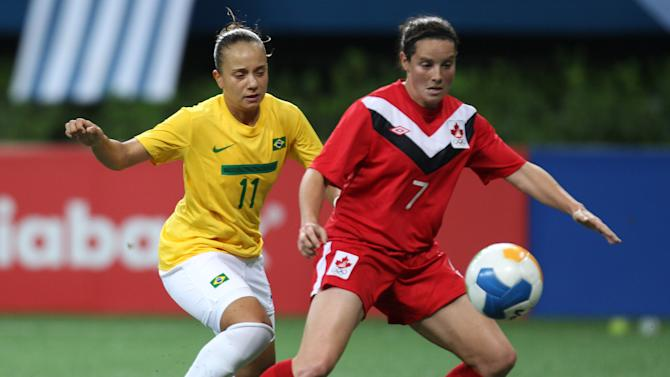 Canada's Rhian Wilkinson, right, fights for the ball with Brazil's Thais Guedes during a women's soccer match at the Pan American Games in Guadalajara, Mexico, Saturday, Oct. 22, 2011. (AP Photo/Juan Karita)