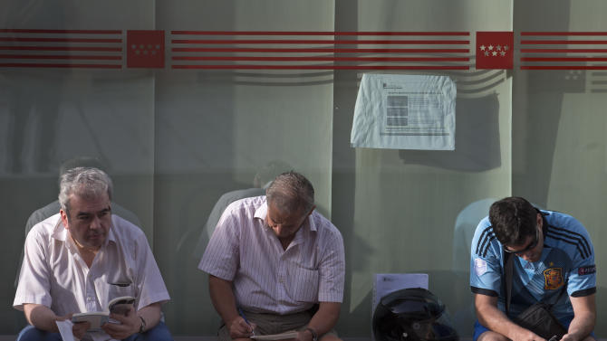 People wait to enter an unemployment registry office in Madrid, Spain, Friday, Aug. 2, 2013. Spain's Labor Ministry said Friday the number of people registered as unemployed dropped for a fifth consecutive month in July as the busy summer tourist season continued to create jobs. The ministry said Friday the total number of people registered as jobless fell by 64,866 last month to a rounded total of 4.69 million, giving it an unemployment rate of 26.3 percent. (AP Photo/Paul White)
