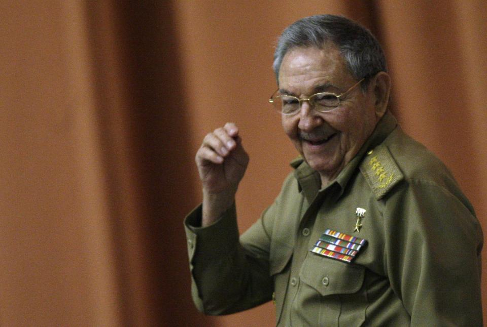 Cuba's President Raul Castro smiles as he arrives for a session of the National Assembly in Havana, Cuba, Thursday, Dec. 13, 2012. The session is one of the National Assembly's twice-yearly gatherings. (AP Photo/Ismael Francisco, Cubadebate)