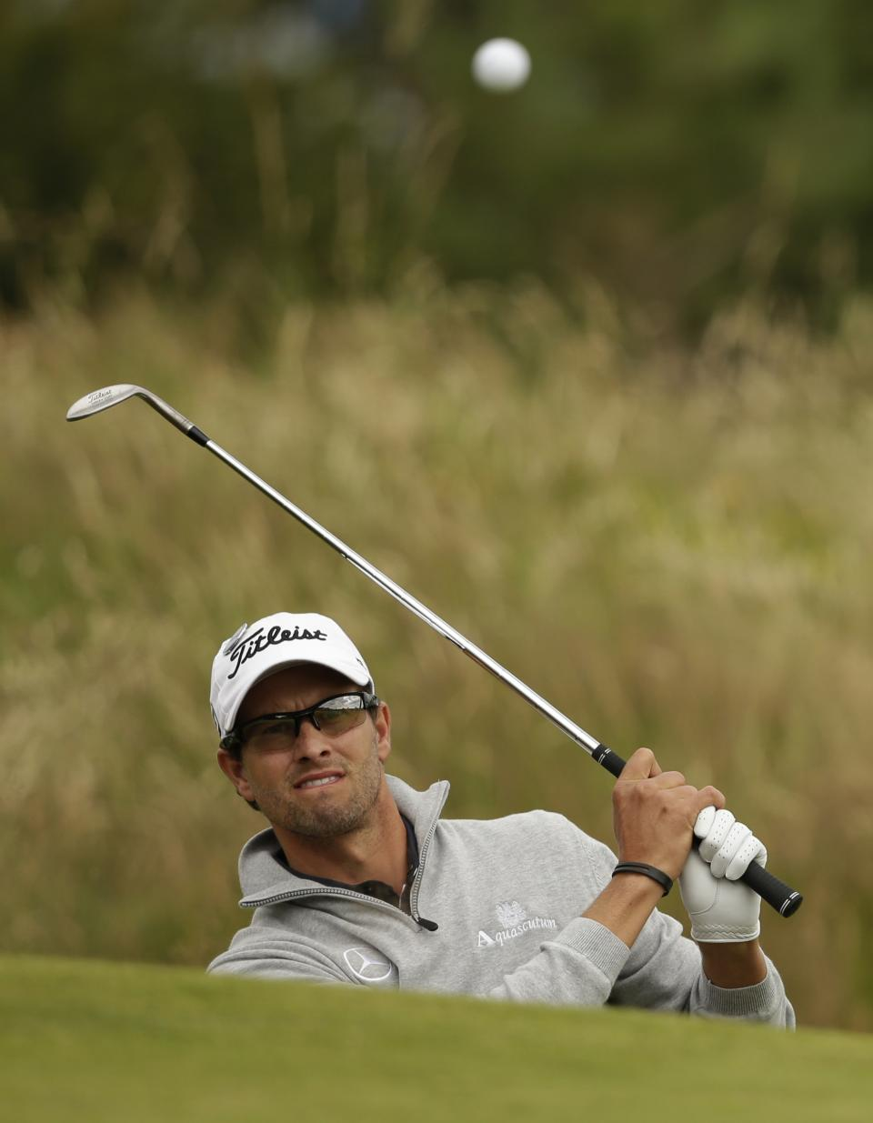 Adam Scott of Australia plays out of a bunker on the 12th hole at Royal Lytham & St Annes golf club during the second round of the British Open Golf Championship, Lytham St Annes, England, Friday, July 20, 2012. (AP Photo/Tim Hales)