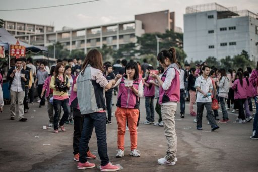 <p>Employees of Taiwanese electronics manufacturer Foxconn are shown at the end of a work day outside the company's compound in Shenzhen.The factories that have powered China's economic miracle are reeling from the global slowdown, presenting the incoming leadership in Beijing with a restless workforce at a defining moment in the country's growth story.</p>