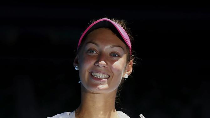 Mihalikova of Slovakia poses with the trophy after defeating Swan of Britain in their junior girls' singles final match at the Australian Open 2015 tennis tournament in Melbourne