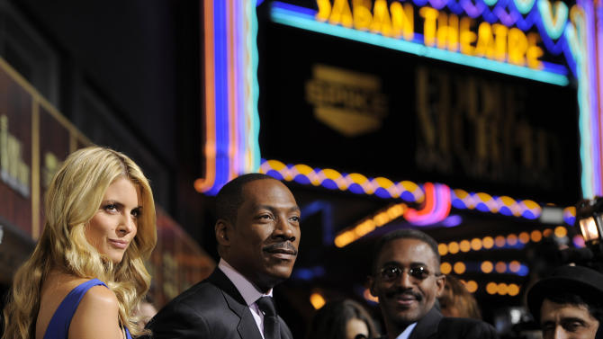 """Eddie Murphy, second from left, arrives with his date Paige Butcher at """"Eddie Murphy: One Night Only,"""" a celebration of Murphy's career at the Saban Theater on Saturday, Nov. 3, 2012, in Beverly Hills, Calif. (Photo by Chris Pizzello/Invision)"""